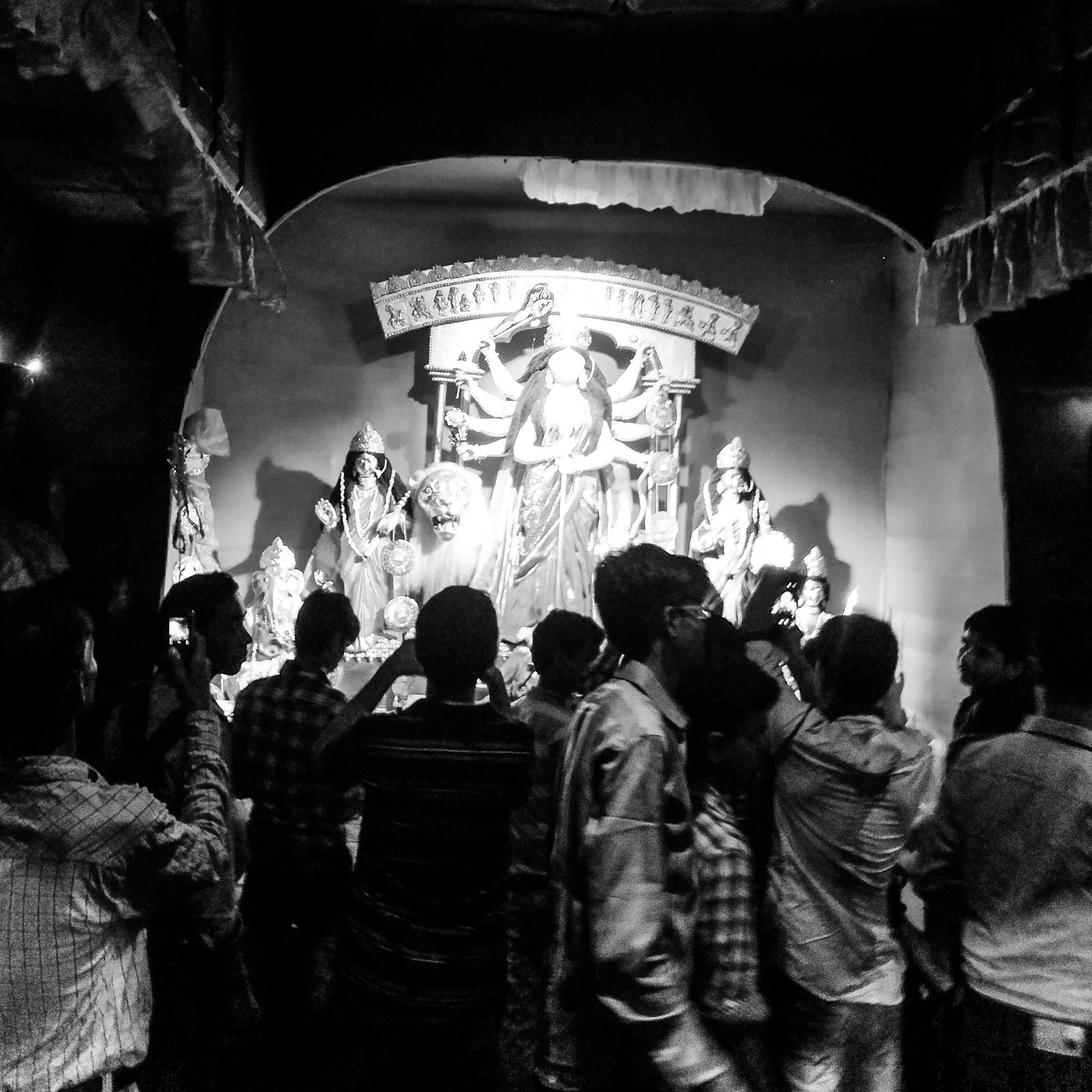 Walking through the narrow lanes, we stop at a 'regular' small community puja, thronged by late night puja crowds, a staple of the city in this festival week every year. The Hijras' puja was a contrast, there were no other visitors besides us but the impersonality of this faceless crowd at a nameless puja was countered there by the visible presence of a large group of Hijras sitting around, chatting and laughing.