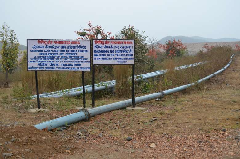 The corporation's scientists dispute that the ponds are toxic or even harmful. But the wording they chose for signage reflects this belief, stating that walking over the tailings is 'unhealthy and undesirable'. Several reports link these sites to congenital conditions and many deaths. (Photo:Ashish Birulee)