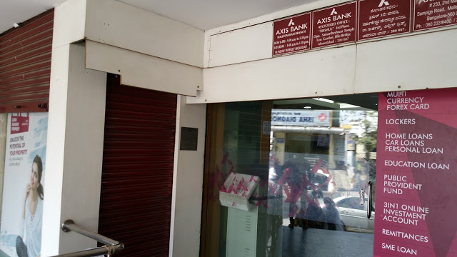 AXIS Bank ATM. The ATM is behind the closed shutter on the left.