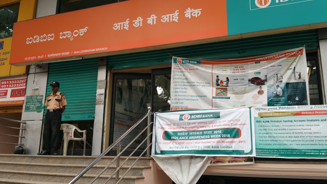 IDBI Bank. The ATM is behind the guard on the left, shutters half down.