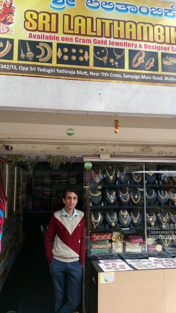 The owner of Sri Lalithambike, posing in front of his shop